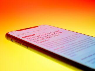 black android smartphone on orange surface